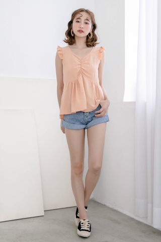 BUTTER DAY RUFFLE TOP IN BABY CORAL
