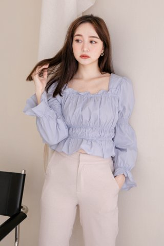 ALMOND BUTTER FRENCH RUFFLED HEM TOP IN BABY BLUE