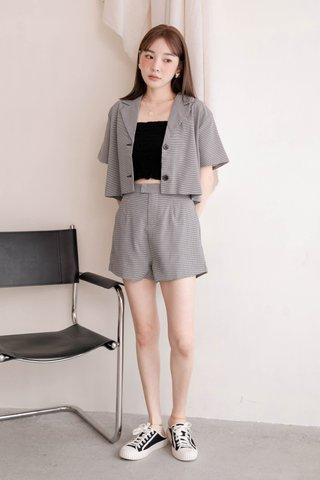 RAINIE KR LETTUCE EDGE SMOCKED TOP IN BLACK