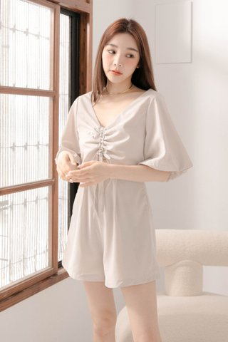 RAINIE HONEY KR RUCHED ROMPER IN DUSTY MILK